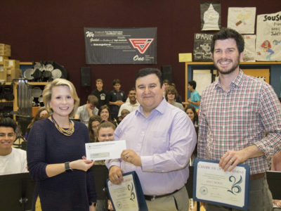 TRTA Associate Director Cindee Sharp presents the $500 grant check to teachers Jesus Torres and Matt Morey.